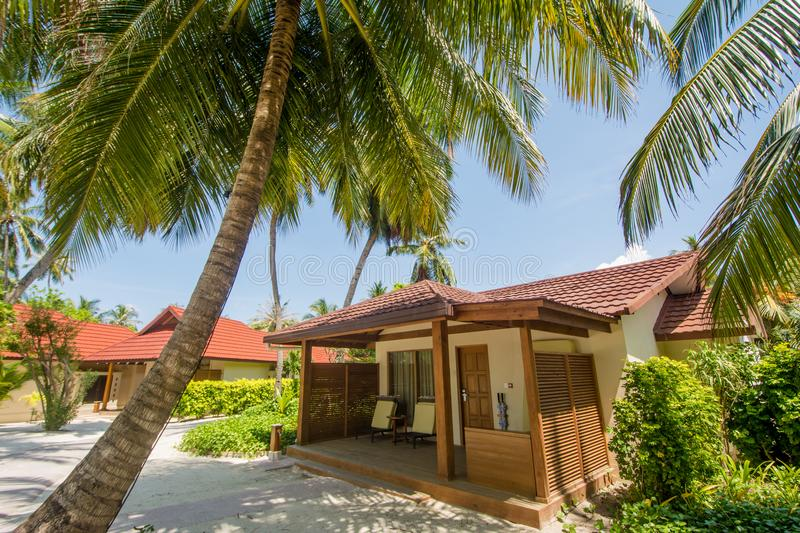 Luxury beautiful small villa on the exotic beach located at the tropical island. In Maldives royalty free stock photography