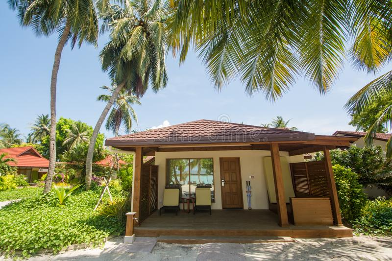 Luxury beautiful villa on the exotic beach located at the tropical island. In Maldives royalty free stock photos