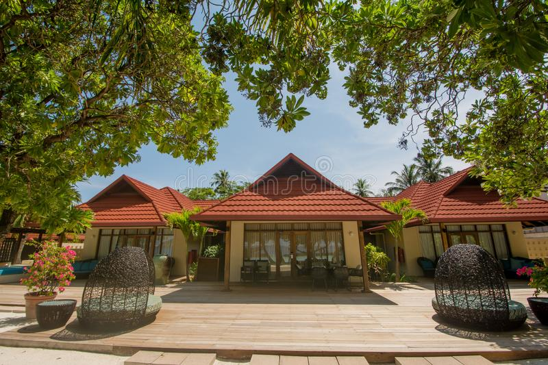 Luxury beautiful villa on the exotic beach located at the tropical island resort. In Maldives royalty free stock image