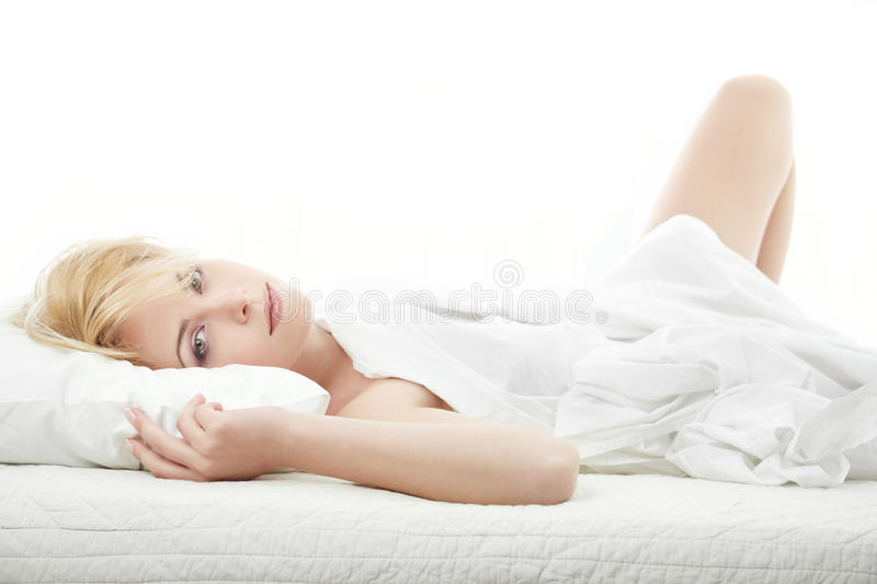 Luxury on the bed. Lady laying on the bed at the morning stock photos
