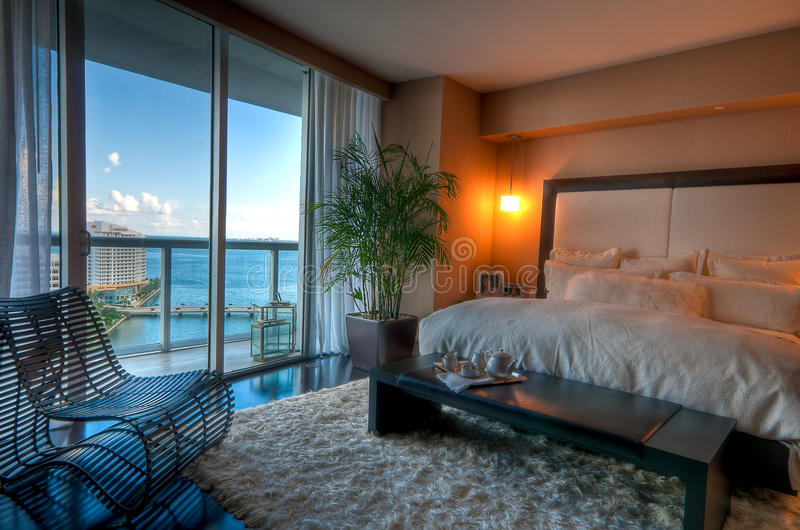 Luxury Bedroom. View of luxury apartment bedroom with view to the bay stock images