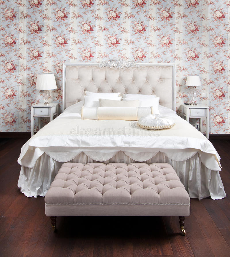 Luxury bedroom. Flower wallpapers on the wall stock images