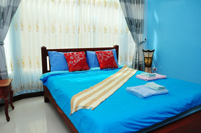 Luxury bedroom. Luxury blue tone bedroom in resort stock photography