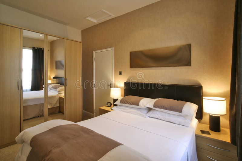 Luxury bedroom. In a hotel apartment royalty free stock photo