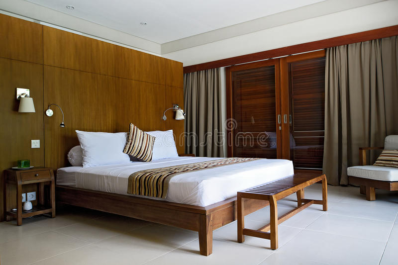 Luxury bedroom Interior. Interior with brown tones of a luxury villa bedroom. in Bali, Indonesia royalty free stock image