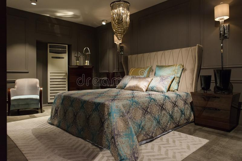 Luxury bedroom interior with carved wood bed, dresser and nights. Tands. Luxury apartment, interior, comfortable bedroom royalty free stock image