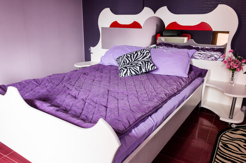 Luxury bedroom. Luxurious bedroom with a double bed in purple stock image
