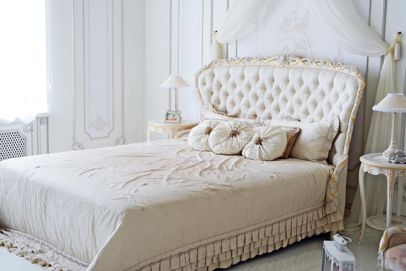 Luxury bedroom. In romantic style bedroom royalty free stock images