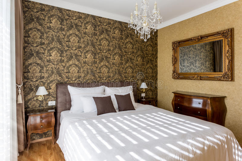 Luxury bedroom. With wallpaper and king sized bed stock photography