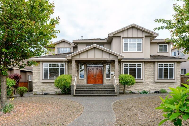 Luxury beige house with a big wooden door stock photos
