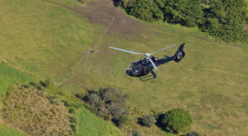 A luxury black helicopter. Flying by royalty free stock photography