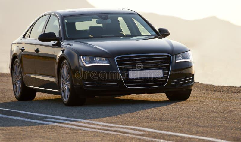 Luxury black sedan vehicle stock photo