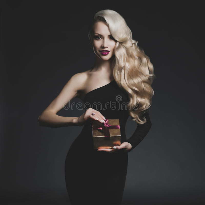 Luxury blonde with a Christmas gift stock image