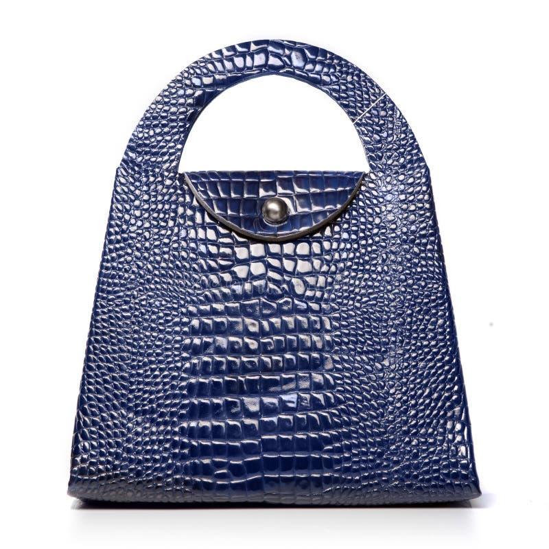 Luxury blue leather female bag. Isolated on white stock images