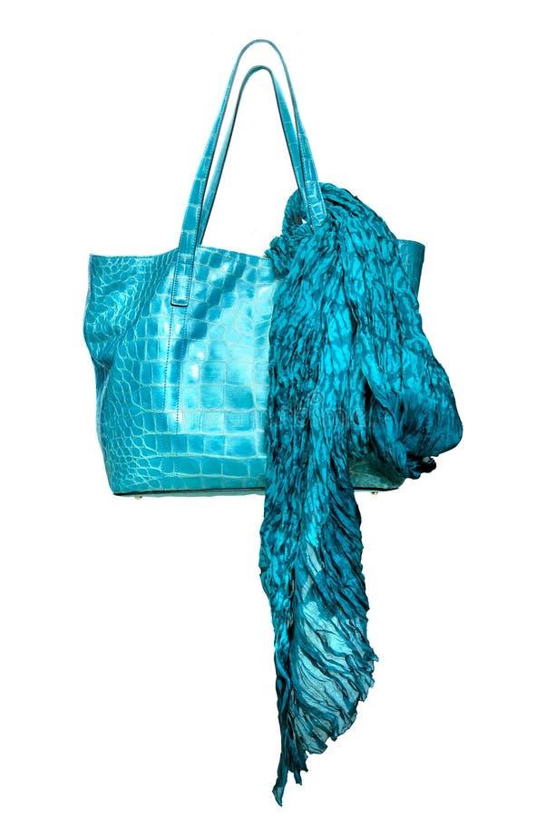 Luxury blue leather female bag with shawl. Isolated on white stock image