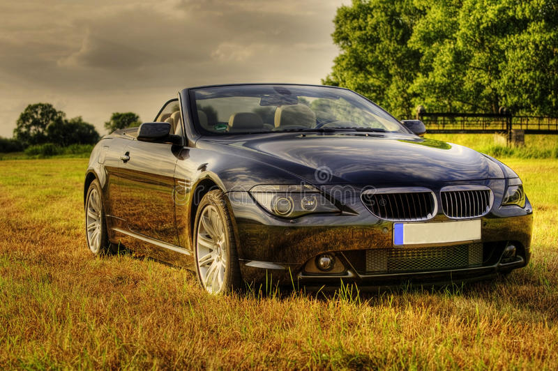 Luxury bmw cabriolet in rural scene, hdr royalty free stock images