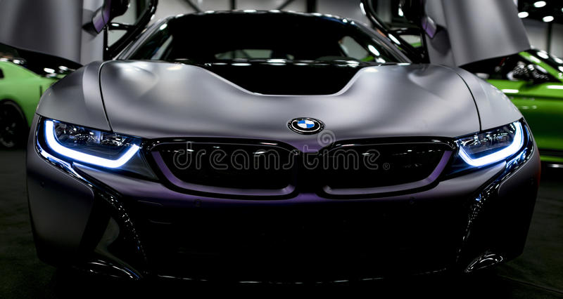 Luxury BMW i8 hybrid electric coupe. Plug-in hybrid sport car. Concept electric vehicle. Dark Matt colour. Car exterior details. royalty free stock photography