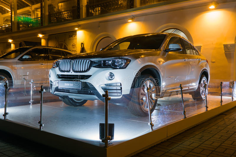 Luxury Bmw x4 at night, new model of the brand BMW near the dealers showroom. Sochi, Russia - October 12, 2016: Luxury Bmw x4 at night, new model of the brand stock photo