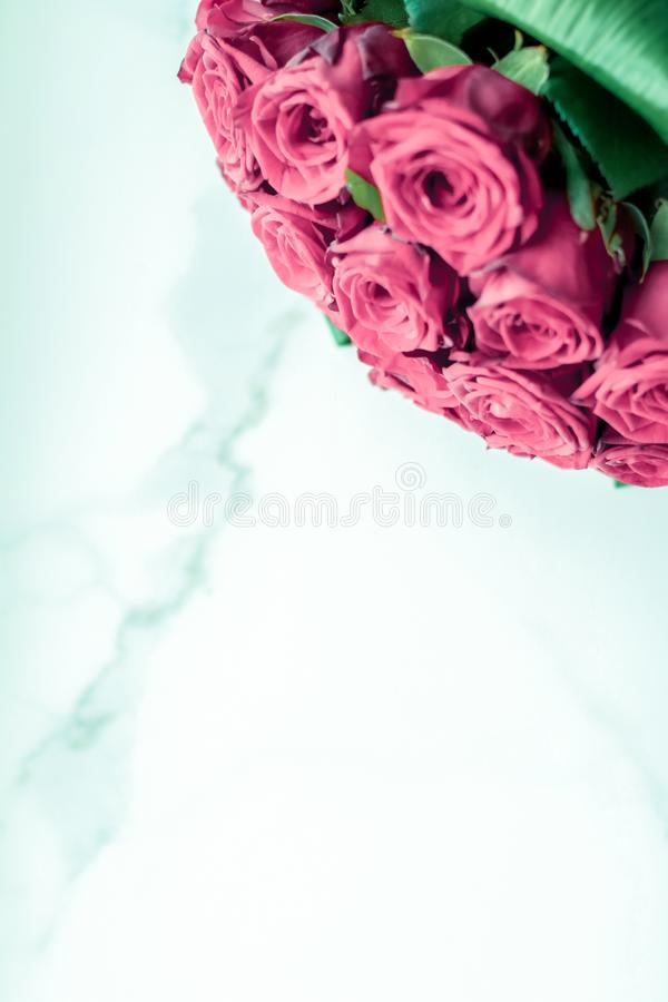 Luxury bouquet of pink roses on marble background, beautiful flowers as holiday love present on Valentines Day stock image