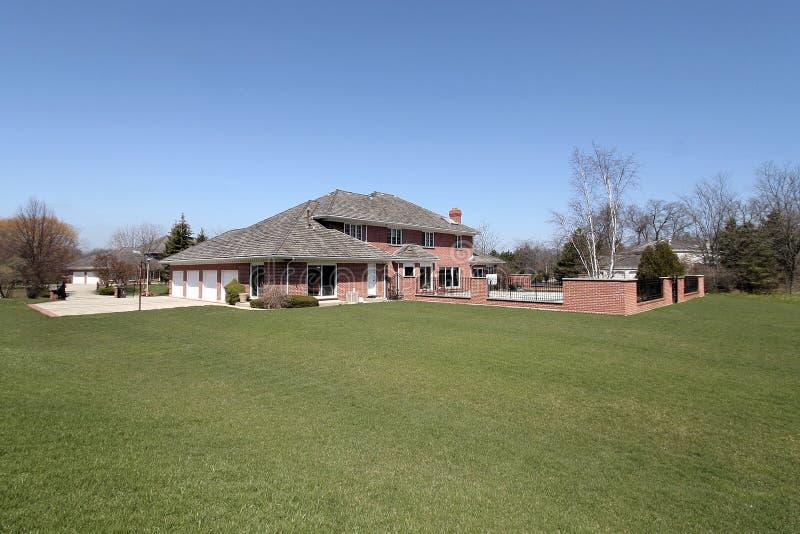 Luxury brick home. With large back yard stock images