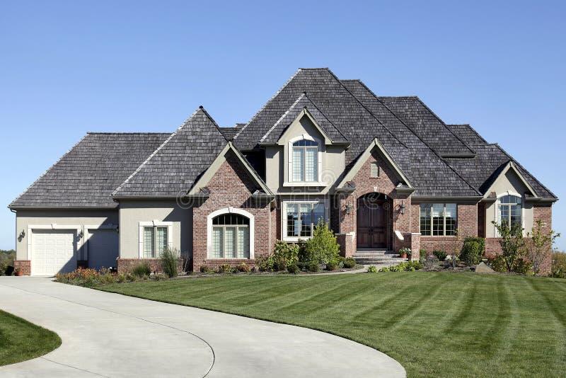Luxury brick home stock image