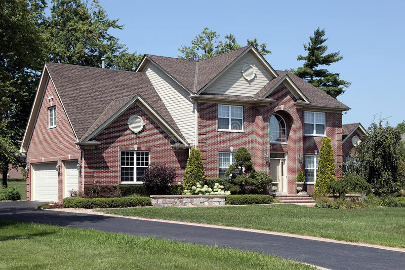 Luxury brick home with arched entry. Luxury brick home in suburbs with arched entry stock photo