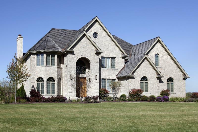 Luxury brick home with cedar roof. Luxury brick home in suburbs with cedar roof royalty free stock images