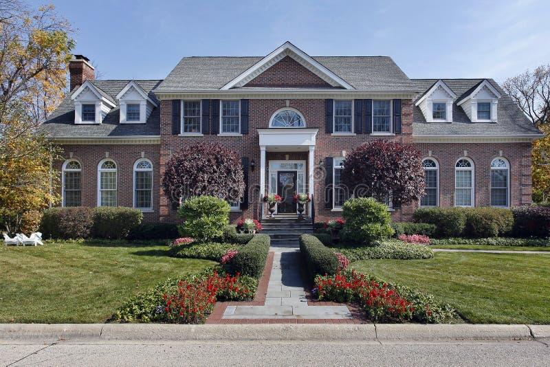 Luxury brick home with columns stock photos