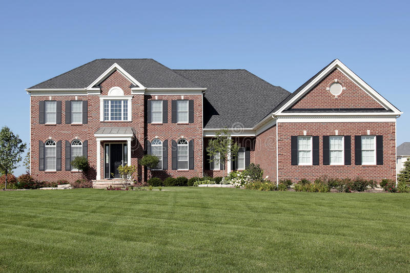 Luxury brick home with covered entrance royalty free stock photos