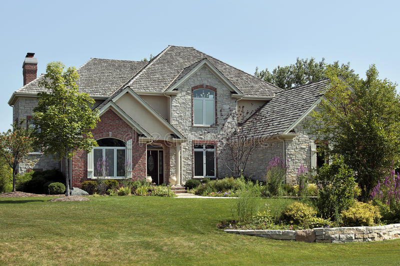 Luxury brick home with stone terrace royalty free stock image