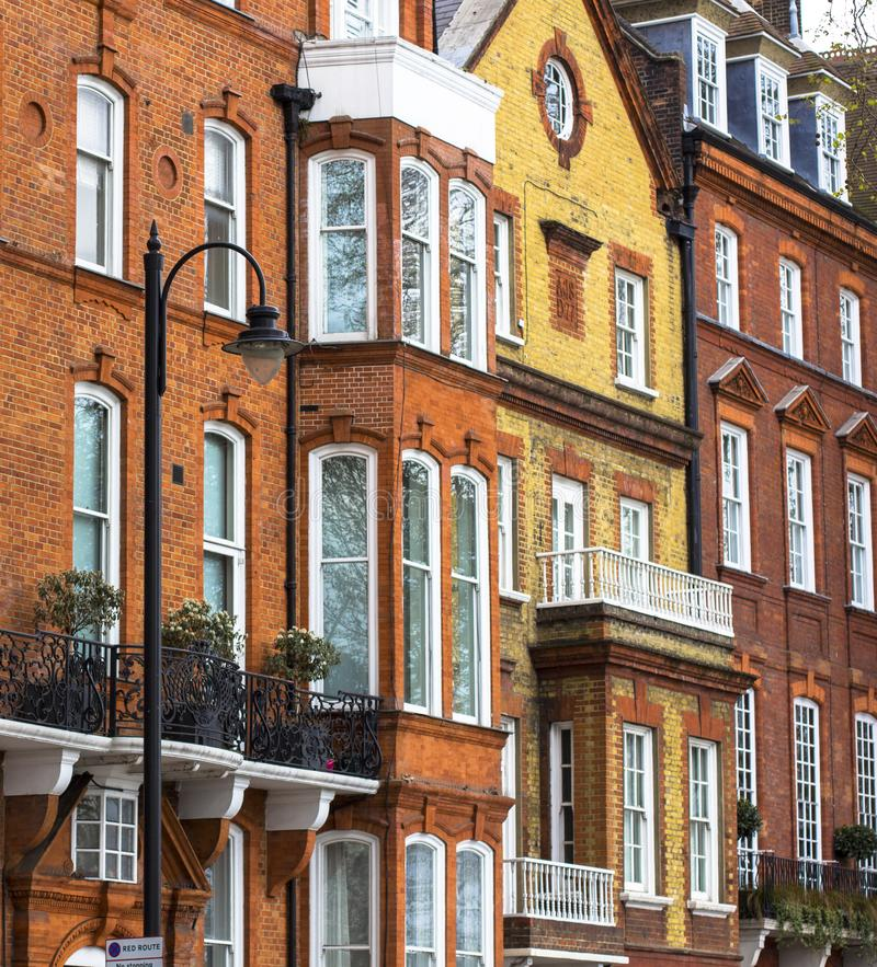 Luxury brick house with white windows in quiet area in central London. Apartments on the banks of the Thames royalty free stock images