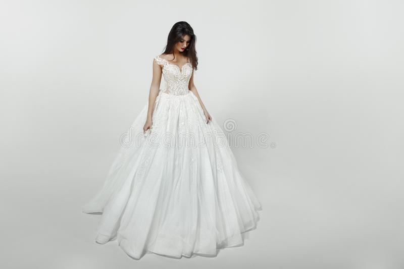 Girl in white princess fashion wedding dress, isolated on a white background. stock photography