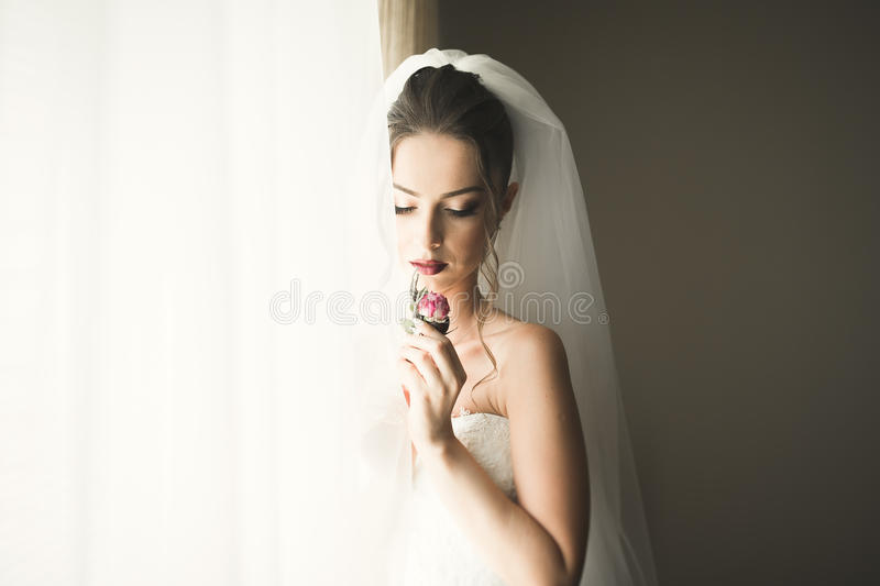 Luxury bride on the morning of wedding day royalty free stock photography