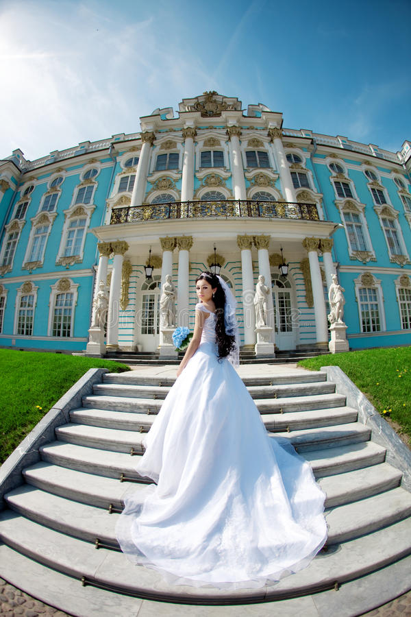 Luxury bride near palace stock image