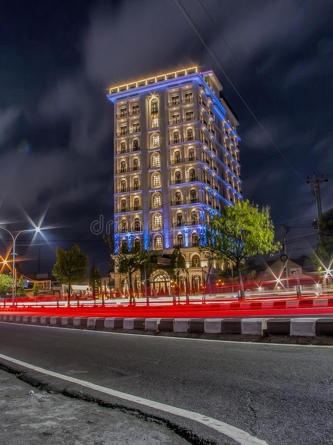 A luxury building at night with beautiful traffic lights. Long exposure photography stock image