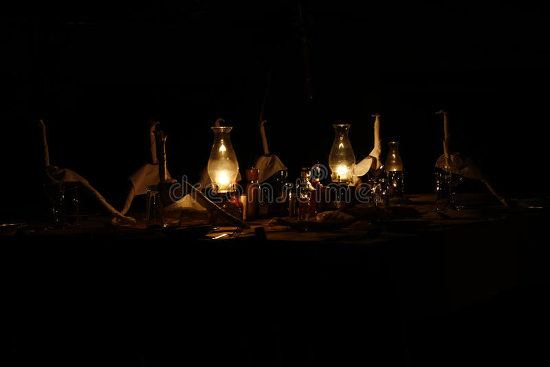 Luxury in the bush Glamping. On safari Glamping is the only way to do it, paraffin lamps light the way for our luxury camping eating & drinking stock photography