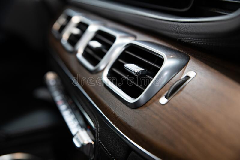 Luxury car air vents and air conditioning. Modern car royalty free stock photos