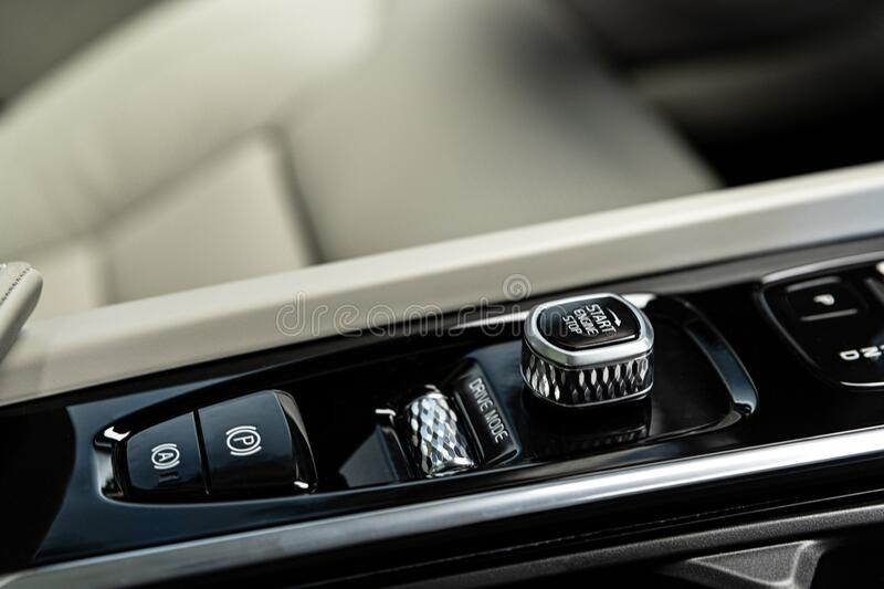 Luxury car control panel with start stop engine switch. Modern car royalty free stock images