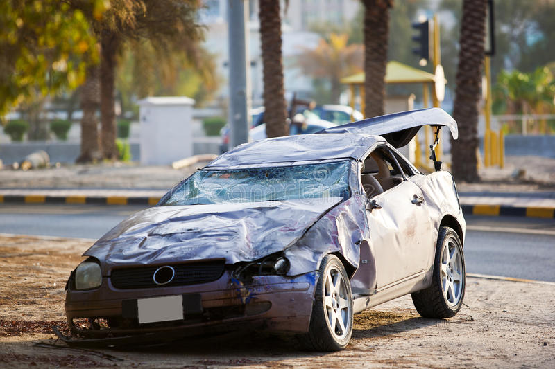 Luxury car crash. A luxury car that has flipped a settled on the pavement royalty free stock photography
