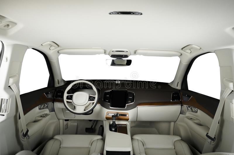 Luxury car inside. Interior of prestige modern car. Comfortable leather seats. White leather and wood cockpit royalty free stock photos