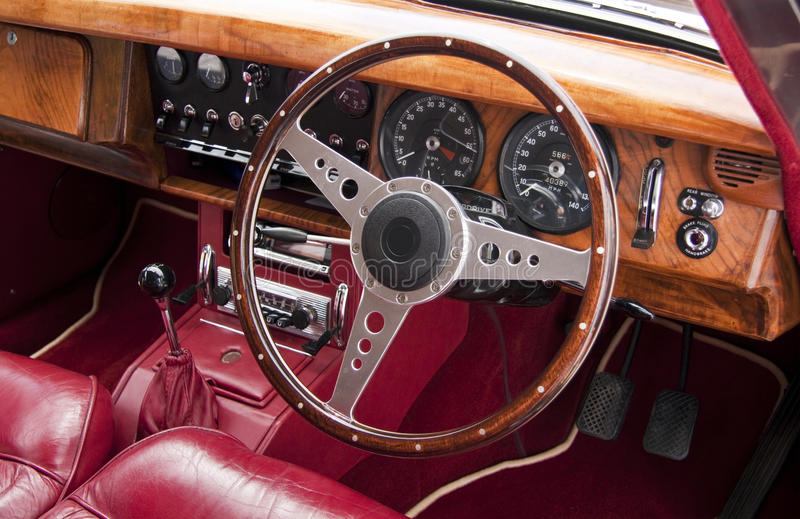 Luxury car interior. Luxury classic car with a wood and leather interior royalty free stock photo