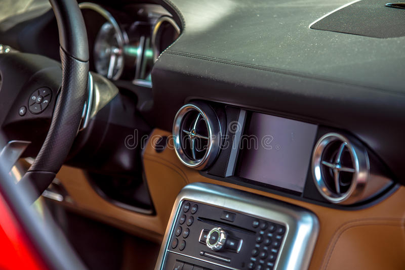 Luxury car interior dash steering wheel and controls royalty free stock images