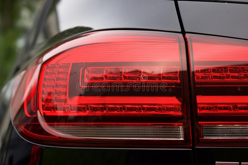 Luxury car rear light- closeup view stock photos