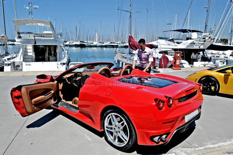 Luxury car on show in a marina royalty free stock image