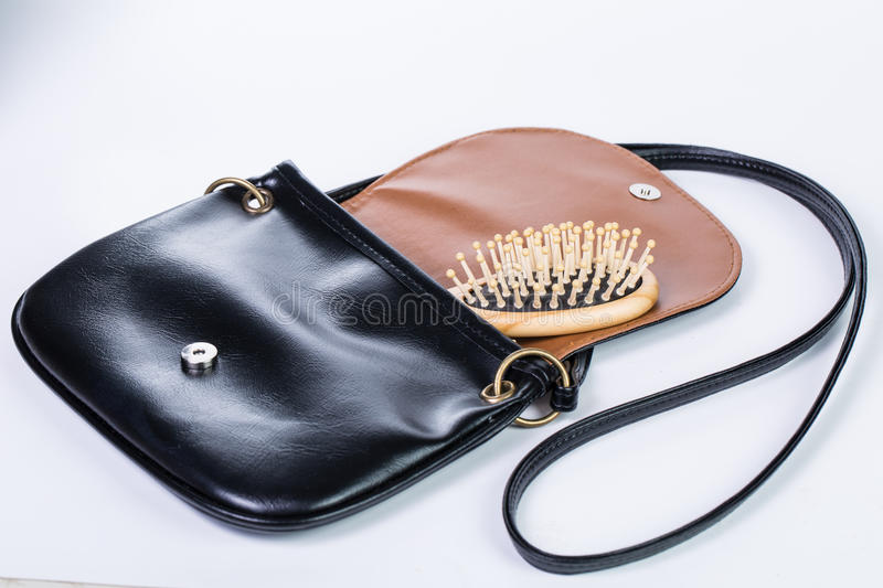 Luxury carry bag black color. And Wood comb with white background stock photos