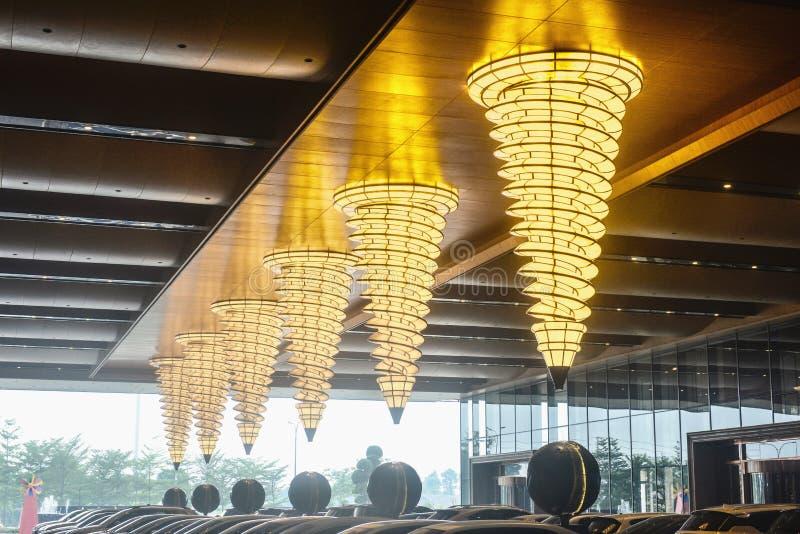 Luxury chandelier lighting in hotel corridor. Shape Luxury chandeliers in hotel corridor at night royalty free stock images