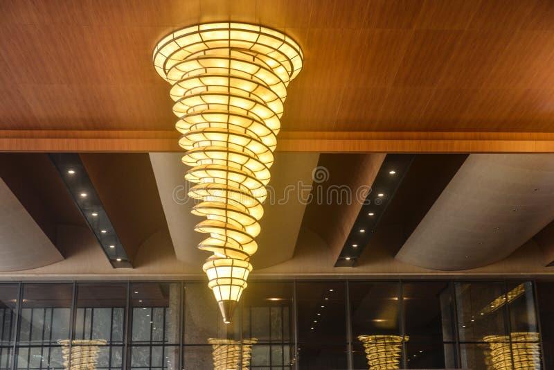 Luxury chandelier lighting in hotel corridor. Shape Luxury chandeliers in hotel corridor at night stock photos