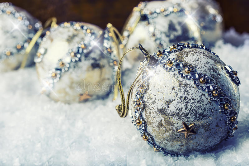 Luxury Christmas ball in the snow and snowy abstract scenes. Christmas ball on glitter background. Christmas time. Luxury Christmas ball in the snow and snowy royalty free stock photo