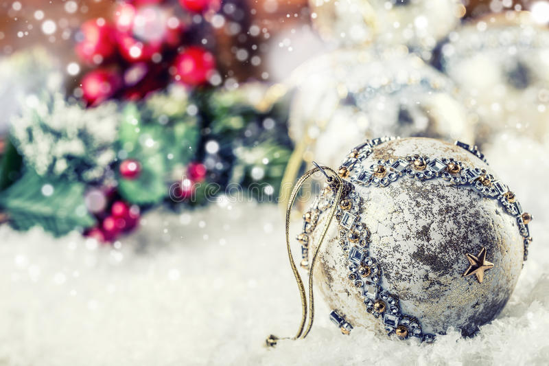 Luxury Christmas ball in the snow and snowy abstract scenes. Christmas ball on glitter background. Christmas time. Luxury Christmas ball in the snow and snowy royalty free stock image