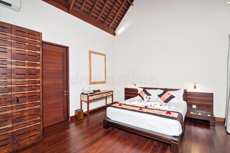 Luxury and Classic Bedroom Villa Hotel. Beautiful interior and Bedroom villa and Hotel in Bali style property, Indonesia with wooden style furniture royalty free stock photos